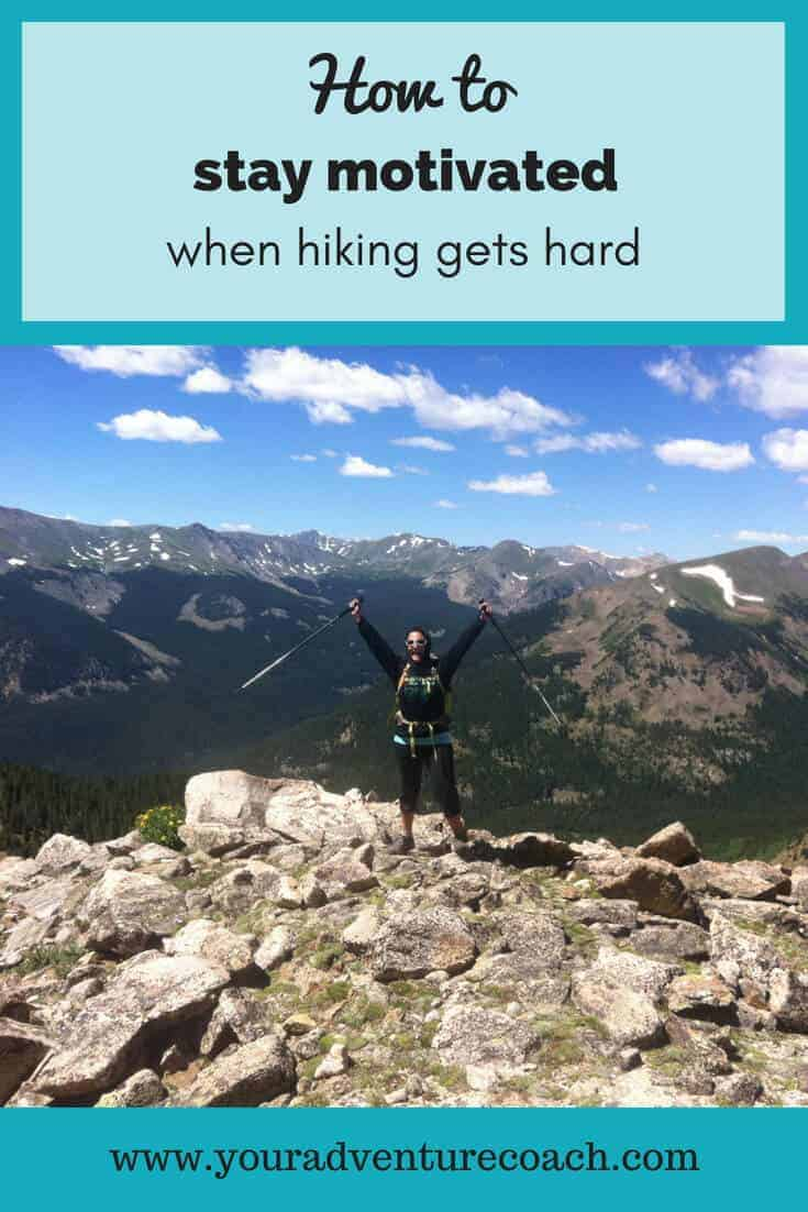 how to stay motivated while hiking picturing a female hiker on a mountain trail