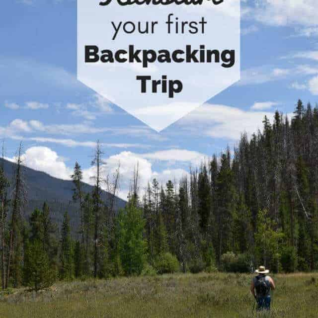 male backpacker on the trail with pine trees, mountains and blue sky with 5 ways to kickstart your first backpacking trip text overlay